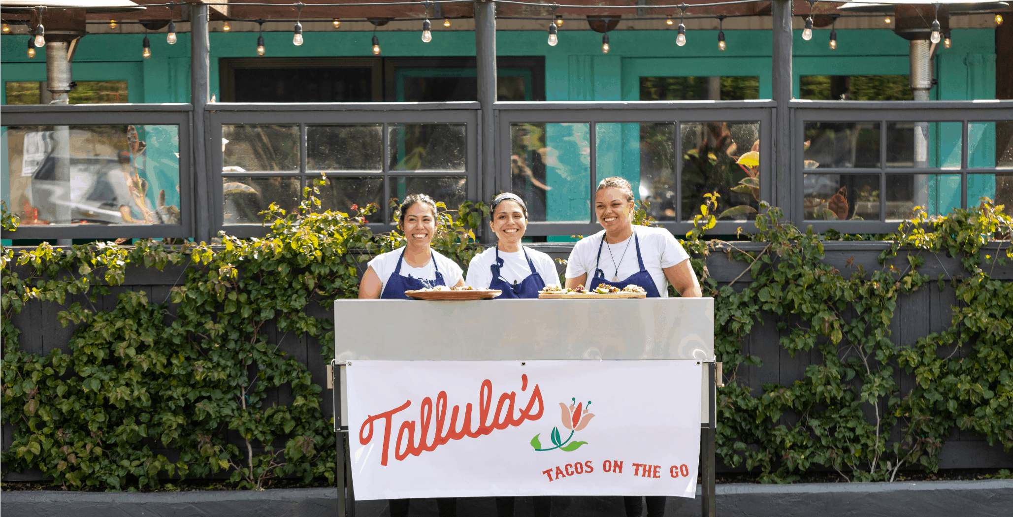 Chefs standing at Tallula's taco cart