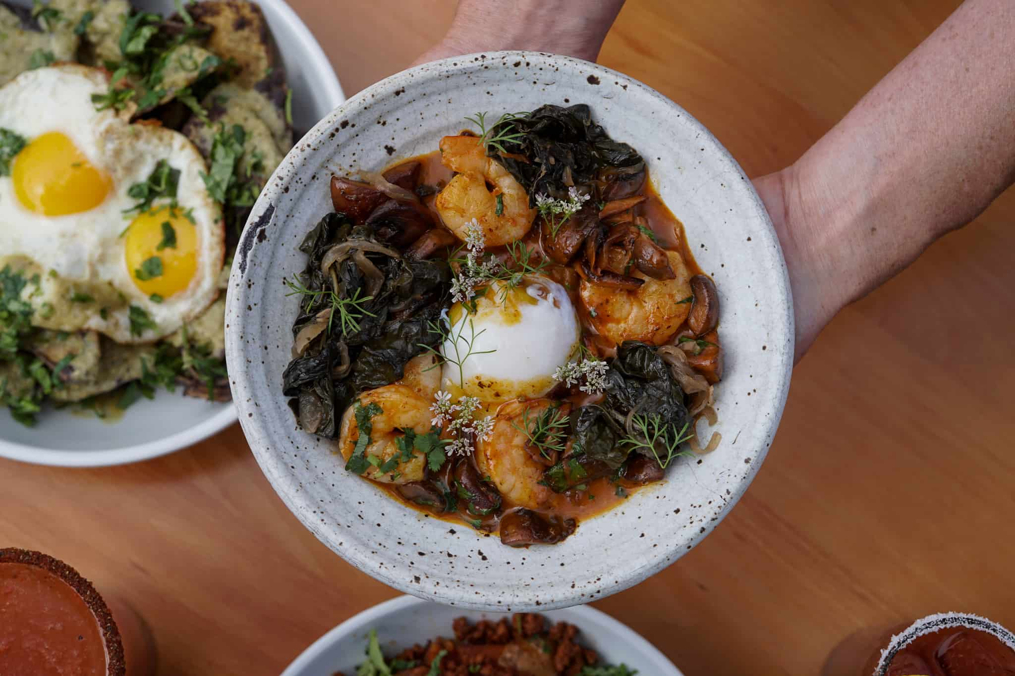 Variety of brunch dishes; featuring shrimp & masa polenta